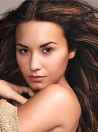 Demi Lovato Talks Beauty, Scars and Tattoos with Glamour January 2012