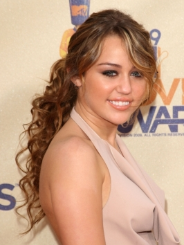 Miley Cyrus Curly Low Pony Hairstyle