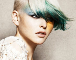 Short Punk Hairstyle With Long Green Bangs