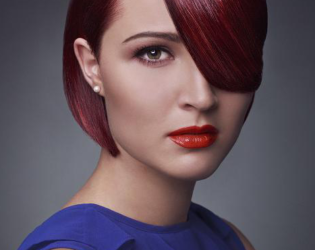 Sleek Bob Hairstyle With Bangs And A Deep Part