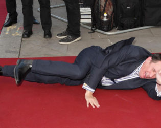 Jools Holland Falling On The Red Carpet